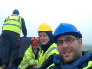 James Field, Counsellor, wearing a hard hat and high-vis jacket on site.